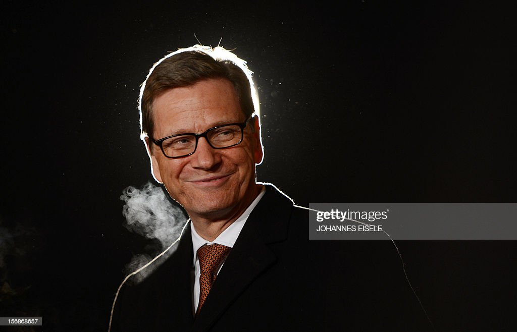 German Foreign Minister Guido Westerwelle waits guests at the foreign ministry's guesthouse Villa Borsig outside Berlin on November 22, 2012. Westerwelle met some of his eastern European counterparts for dinner. AFP PHOTO / JOHANNES EISELE