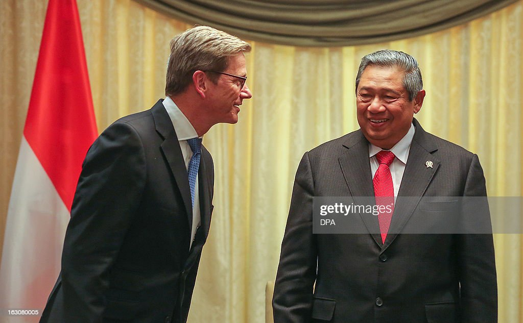 German Foreign Minister Guido Westerwelle (L) welcomes Indonesian President Susilo Bambang Yudhoyono (R) at the Hotel Adlon in Berlin, Germany, on March 4, 2013. President Yudhoyono arrived in Germany to open the International Tourism Bourse ITB. Indonesia is the 2013 official partner country of the world's leading travel trade show, running from March 6-10, 2013.