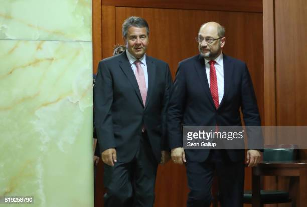 German Foreign Minister Sigmar Gabriel and German Social Democrat and chancellor candidate Martin Schulz emerge before Gabriel spoke to the media...
