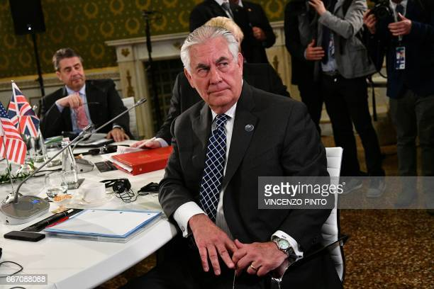 German Foreign Minister Sigmar Gabriel and US Secretary of State Rex Tillerson sit at a table on the second day of a meeting of Foreign Affairs...