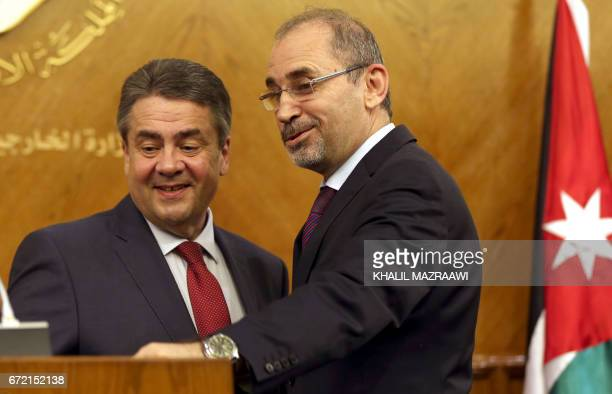 German Foreign Minister Sigmar Gabriel chats with his Jordanian counterpart Ayman Safadi during a press conference in Amman on April 24 2017 / AFP...