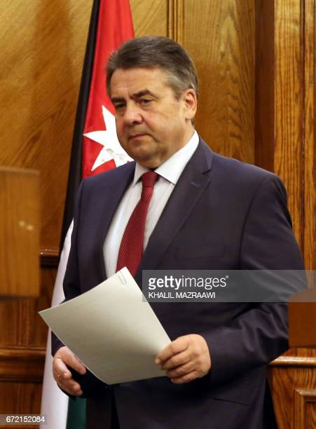 German Foreign Minister Sigmar Gabriel holds a press conference after his meeting with his Jordanian counterpart in Amman on April 24 2017 / AFP...