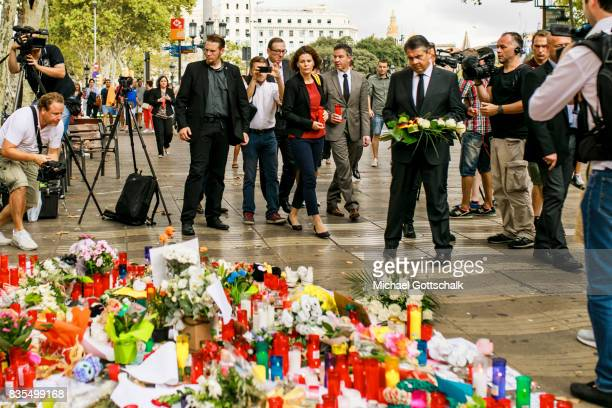 German Foreign Minister Sigmar Gabriel lays flowers as he visits Las Ramblas near the scene of Thursday's terrorist attack on August 19 2017 in...