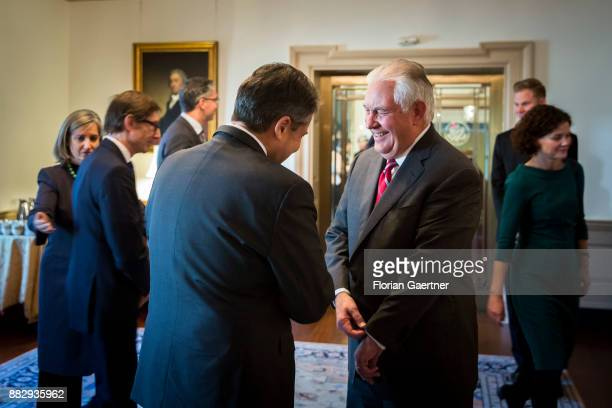 German Foreign Minister Sigmar Gabriel talks with Secretary of State Rex Tillerson on November 30 2017 in Washington DC According to reports...