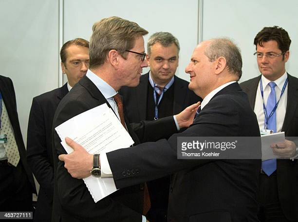 German Foreign Minister Westerwelle shakes hands with his Serbian counterpart Ivan Mrkic at the 20st OSCE Foreign Ministers meeting on December 05...