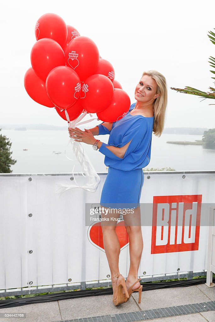 German former rhythmic gymnast <a gi-track='captionPersonalityLinkClicked' href=/galleries/search?phrase=Magdalena+Brzeska&family=editorial&specificpeople=225040 ng-click='$event.stopPropagation()'>Magdalena Brzeska</a> during the 'Ein Herz fuer Kinder' summer party at Wannseeterrassen on May 26, 2016 in Berlin, Germany.