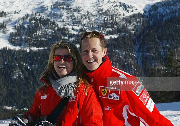 German Formula 1 driver Michael Schumacher poses with his wife Corinna in the winter resort of Madonna di Campiglio in the Dolomites area Northern...