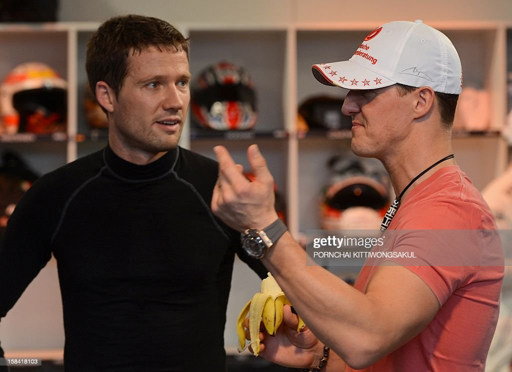 German Formula One driver and seven times world champion Michael Schumacher (R) talks with French driver Sebastien Ogier (L) during a warm-up for the Race of Champions (ROC) at Rajamangala Stadium in Bangkok on December 16, 2012. The Race of Champions (ROC) will take place in Thailand between December 14 and 16 and brings together heavyweights from all motor racing disciplines in the same type of car.