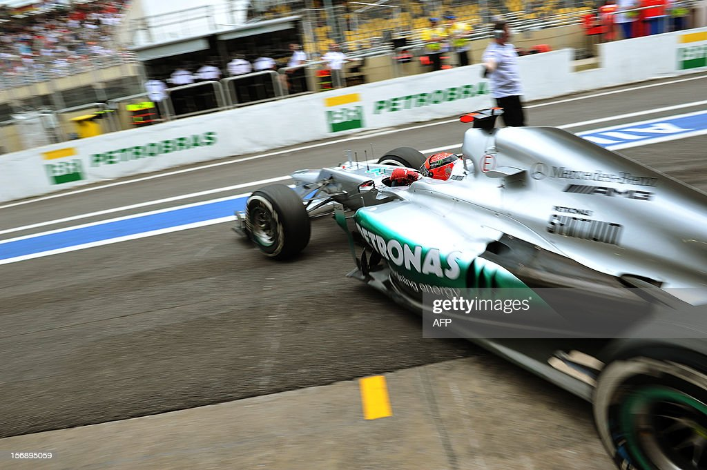 German Formula One driver Michael Schumacher leaves the Mercedes pits on November 24, 2012 during the free practices for the Brazilian GP on Sunday at the Interlagos racetrack in Sao Paulo, Brazil.
