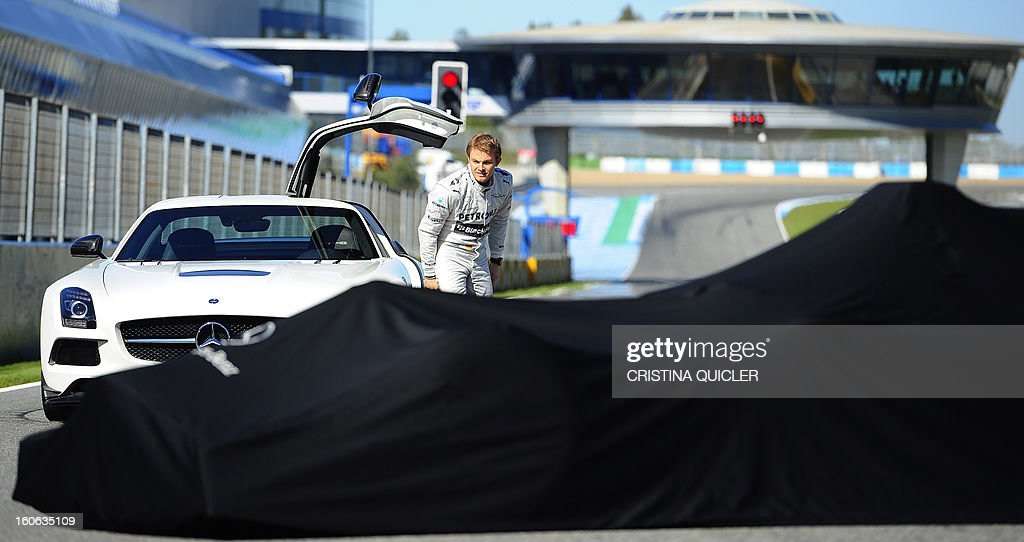 German Formula One driver Nico Rosberg arrives prior to the unveil of the new Mercedes W04 as part of the Formula One training session at Jerez racetrack, on February 4, 2013 in Jerez de la Frontera.