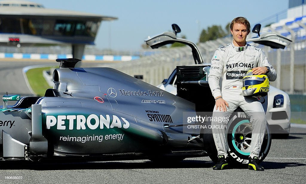 German Formula One driver Nico Rosberg poses with the new Mercedes W04 as part of the Formula One training session at Jerez racetrack, on February 4, 2013 in Jerez de la Frontera.