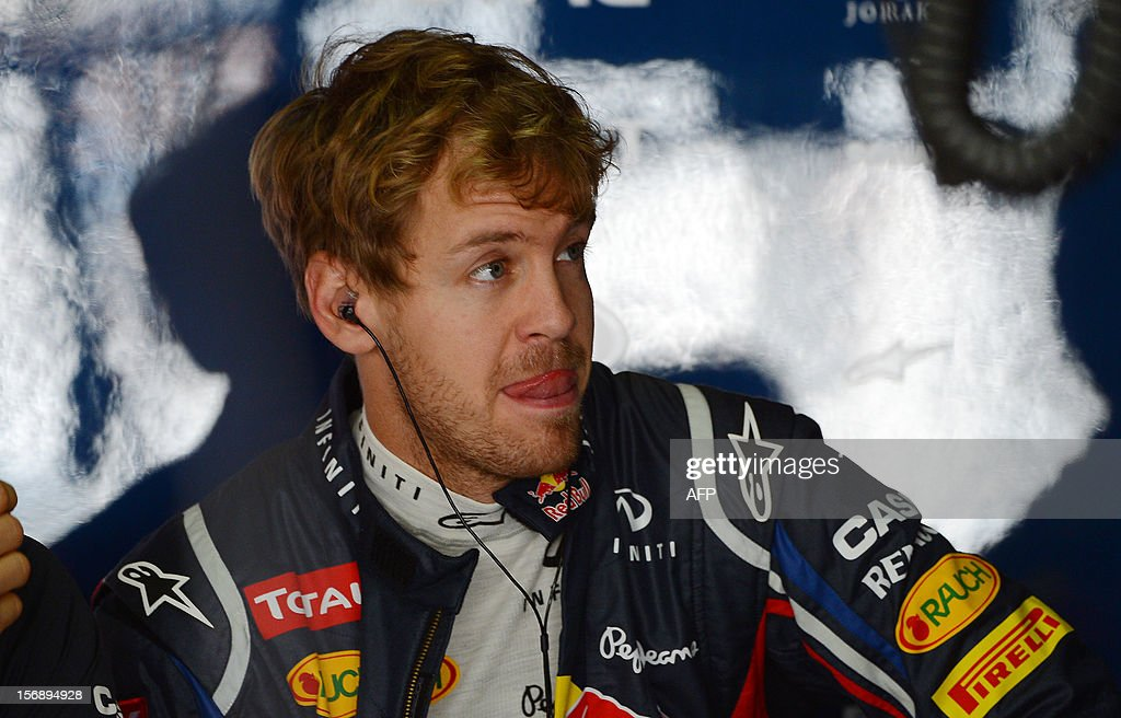 German Formula One driver Sebastian Vettel pictured at the Red Bull pits on November 24, 2012 during the free practices for the Brazilian GP on Sunday at the Interlagos racetrack in Sao Paulo, Brazil. AFP PHOTO