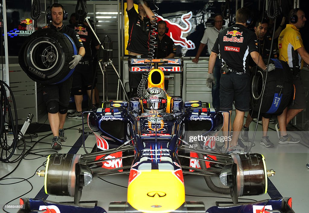 German Formula One driver Sebastian Vettel replaces tires at the Red Bull pits on November 24, 2012 during the free practices for the Brazilian GP on Sunday at the Interlagos racetrack in Sao Paulo, Brazil. AFP PHOTO