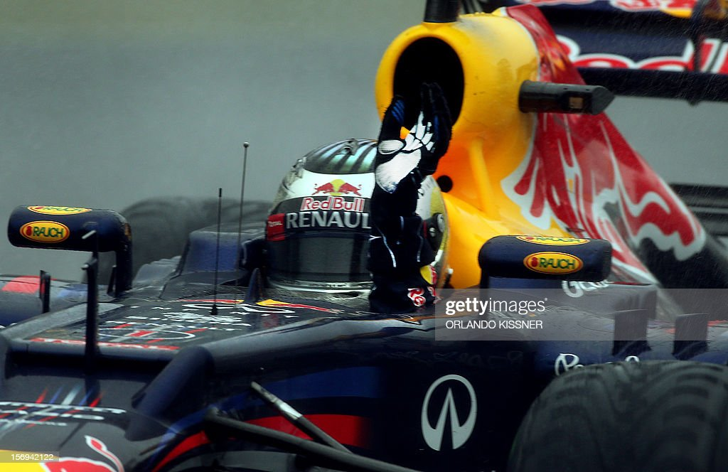 German Formula One driver Sebastian Vettel waves from the car celebrating his third F-1 World Championship after finishing sixth in the Brazil's F-1 GP on November 25, 2012 at the Interlagos racetrack in Sao Paulo, Brazil. AFP PHOTO
