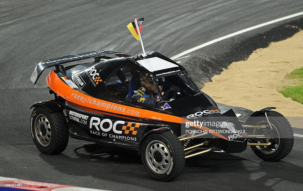 German Formula One World Champion Sebastian Vettel competes in the Race of Champions (ROC) Nations Cup at Rajamangala Stadium in Bangkok on December 15, 2012. The Race of Champions (ROC) will take place in Thailand between December 14 and 16 and brings together heavyweights from all motor racing disciplines in the same type of car.