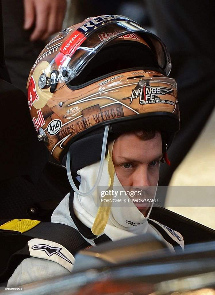 German Formula One World Champion Sebastian Vettel wears a helmet during a practice session ahead of the annual Race of Champions (ROC) at Rajamangala Stadium in Bangkok on December 15, 2012. The Race of Champions (ROC) will take place in Thailand between December 14 and 16 and brings together heavyweights from all motor racing disciplines in the same type of car.
