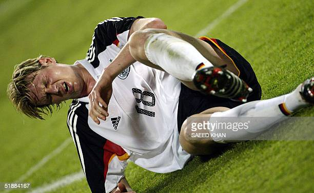 German forward Tim Borowski lies on the pitch after he was injured during a friendly match against Thailand in Bangkok 21 December 2004 Germany won...