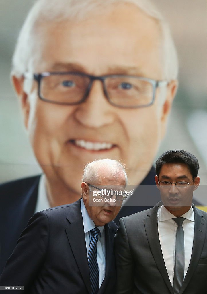 German Free Democrats (FDP) lead candidate Rainer Bruederle (L) and FDP party chairman Philipp Roesler walk past an FDP election campaign poster as they arrive to speak to the media at FDP party headquarters on September 16, 2013 in Berlin, Germany. The FDP faired disastrously in Bavarian state elections held the previous day and failed to get enough votes to retain seats in the Bavarian parliament. Germany faces federal elections on September 22 and the FDP, which is the current German government coalition partner with the German Christian Democrats (CDU), is facing an uphill battle.
