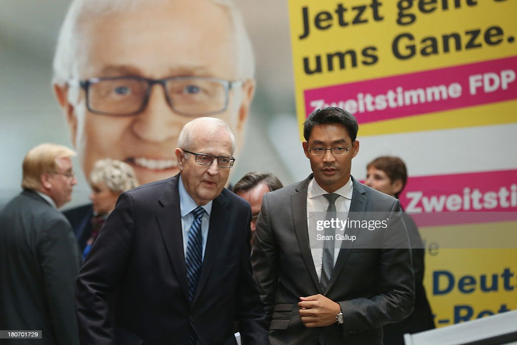 German Free Democrats (FDP) lead candidate <a gi-track='captionPersonalityLinkClicked' href=/galleries/search?phrase=Rainer+Bruederle&family=editorial&specificpeople=2146238 ng-click='$event.stopPropagation()'>Rainer Bruederle</a> (L) and FDP party chairman <a gi-track='captionPersonalityLinkClicked' href=/galleries/search?phrase=Philipp+Roesler&family=editorial&specificpeople=4838791 ng-click='$event.stopPropagation()'>Philipp Roesler</a> walk past an FDP election campaign poster as they arrive to speak to the media at FDP party headquarters on September 16, 2013 in Berlin, Germany. The FDP faired disastrously in Bavarian state elections held the previous day and failed to get enough votes to retain seats in the Bavarian parliament. Germany faces federal elections on September 22 and the FDP, which is the current German government coalition partner with the German Christian Democrats (CDU), is facing an uphill battle.