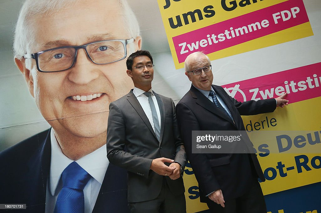 German Free Democrats (FDP) lead candidate <a gi-track='captionPersonalityLinkClicked' href=/galleries/search?phrase=Rainer+Bruederle&family=editorial&specificpeople=2146238 ng-click='$event.stopPropagation()'>Rainer Bruederle</a> (R) and FDP party chairman <a gi-track='captionPersonalityLinkClicked' href=/galleries/search?phrase=Philipp+Roesler&family=editorial&specificpeople=4838791 ng-click='$event.stopPropagation()'>Philipp Roesler</a> stand in front of an FDP election campaign poster after they spoke to the media at FDP party headquarters on September 16, 2013 in Berlin, Germany. The FDP faired disastrously in Bavarian state elections held the previous day and failed to get enough votes to retain seats in the Bavarian parliament. Germany faces federal elections on September 22 and the FDP, which is the current German government coalition partner with the German Christian Democrats (CDU), is facing an uphill battle.