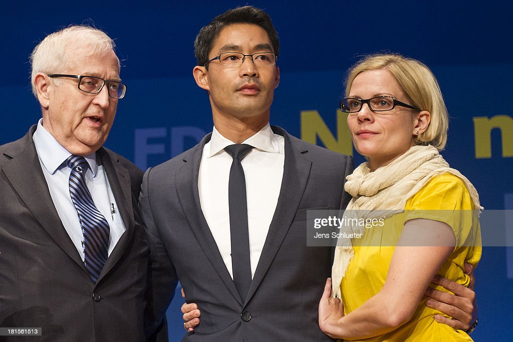 German Free Democrats (FDP) lead candidate <a gi-track='captionPersonalityLinkClicked' href=/galleries/search?phrase=Rainer+Bruederle&family=editorial&specificpeople=2146238 ng-click='$event.stopPropagation()'>Rainer Bruederle</a> (L), <a gi-track='captionPersonalityLinkClicked' href=/galleries/search?phrase=Philipp+Roesler&family=editorial&specificpeople=4838791 ng-click='$event.stopPropagation()'>Philipp Roesler</a>, Chairman of the German Free Democrats (FDP) and his wife Wiebke Roesler stand on the stage during the speech to the supporters of the German Free Democrats (FDP) at FDP party headquarters after the German federal elections on September 22, 2013 in Berlin, Germany. Germany is holding federal elections that will determine whether current Chancellor Angela Merkel of the German Christian Democrats (CDU) will remain for a third term. Though the CDU has a strong lead over the opposition, speculations run wide as to what coalition will be viable in coming weeks to create a new government.