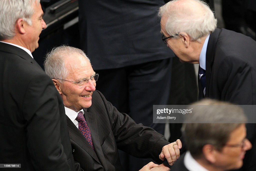 German Free Democrats party (FDP) Bundestag faction leader Rainer Bruederle (R) greets German Finance Minister Wolfgang Schaeuble as they arrive for a joint session of the German Bundestag and French Assemblee Nationale parliaments in the Reichstag building during the 50th anniversary celebration of the Elysee Treaty on January 22, 2013 in Berlin, Germany. The treaty, concluded in 1963 by Charles de Gaulle and Konrad Adenauer in the Elysee Palace in Paris, set a new tone of reconciliation between France and Germany, and called for consultations between the two countries to come to a common stance on policies affecting the most important partners in Europe as well as the rest of the region. Since its establishment, the document for improved bilateral relations has been seen by many as the driving force behind European integration.
