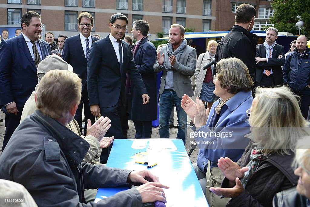 German Free Democrats (FDP) party chairman Philipp Roesler and secretary general Patrick Doering (L) arrives to a party's election campaign on September 19, 2013 in Hanover, Germany. Germany faces federal elections on September 22.