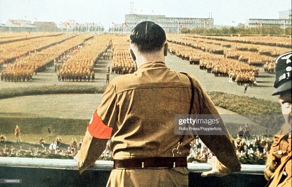 German Fuhrer and Nazi leader Adolf Hitler (1889 - 1945) addresses soldiers with his back facing the camera at a Nazi rally in Dortmund, Germany, circa 1933.