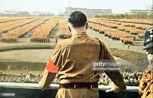 German Fuhrer and Nazi leader Adolf Hitler addresses soldiers with his back facing the camera at a Nazi rally in Dortmund Germany circa 1933