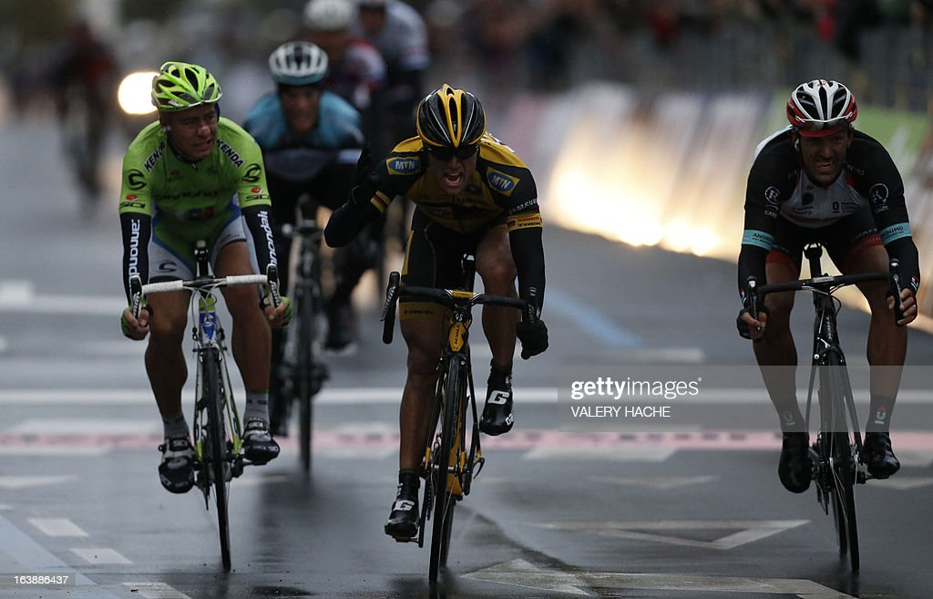 German Gerald Ciolek (C) celebrates as he crosses the finish line ahead Switzerland's Fabian Cancellera (R), third, and Peter Sagan (L), second, to win the 104th Milan San Remo spring classic cycling race on March 17, 2013 in San Remo. Gerald Ciolek of Germany, riding for South African team MTN-Qhueka, won the first cycling classic of the season, the Milan-Sanremo, triumphing in a race curtailed by heavy snow. The poor conditions forced the event to be temporarily halted after 117km. Organisers elected to restart the race for the final 126.5km from Cogoleto, meaning participants would still need to tackle the succession of hills along the Ligurian coast after proceedings were initially halted after 117km.