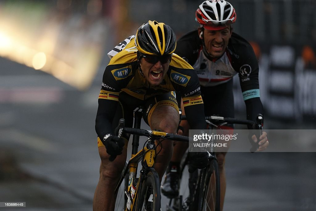 German Gerald Ciolek (L) celebrates as he crosses the finish line ahead Switzerland's Fabian Cancellera (R), third, to win the 104th Milan San Remo spring classic cycling race on March 17, 2013 in San Remo. Gerald Ciolek of Germany, riding for South African team MTN-Qhueka, won the first cycling classic of the season, the Milan-Sanremo, triumphing in a race curtailed by heavy snow. The poor conditions forced the event to be temporarily halted after 117km. Organisers elected to restart the race for the final 126.5km from Cogoleto, meaning participants would still need to tackle the succession of hills along the Ligurian coast after proceedings were initially halted after 117km.