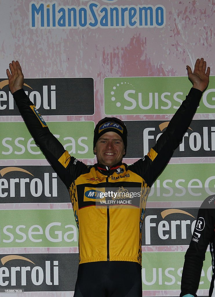German Gerald Ciolek celebrates on the podium after winning the 104th Milan-San Remo classic cycling race on March 17, 2013 in San Remo. Gerald Ciolek of Germany, riding for South African team MTN-Qhueka, won the first cycling classic of the season, the Milan-Sanremo, triumphing in a race curtailed by heavy snow. The poor conditions forced the event to be temporarily halted after 117km. Organisers elected to restart the race for the final 126.5km from Cogoleto, meaning participants would still need to tackle the succession of hills along the Ligurian coast after proceedings were initially halted after 117km.