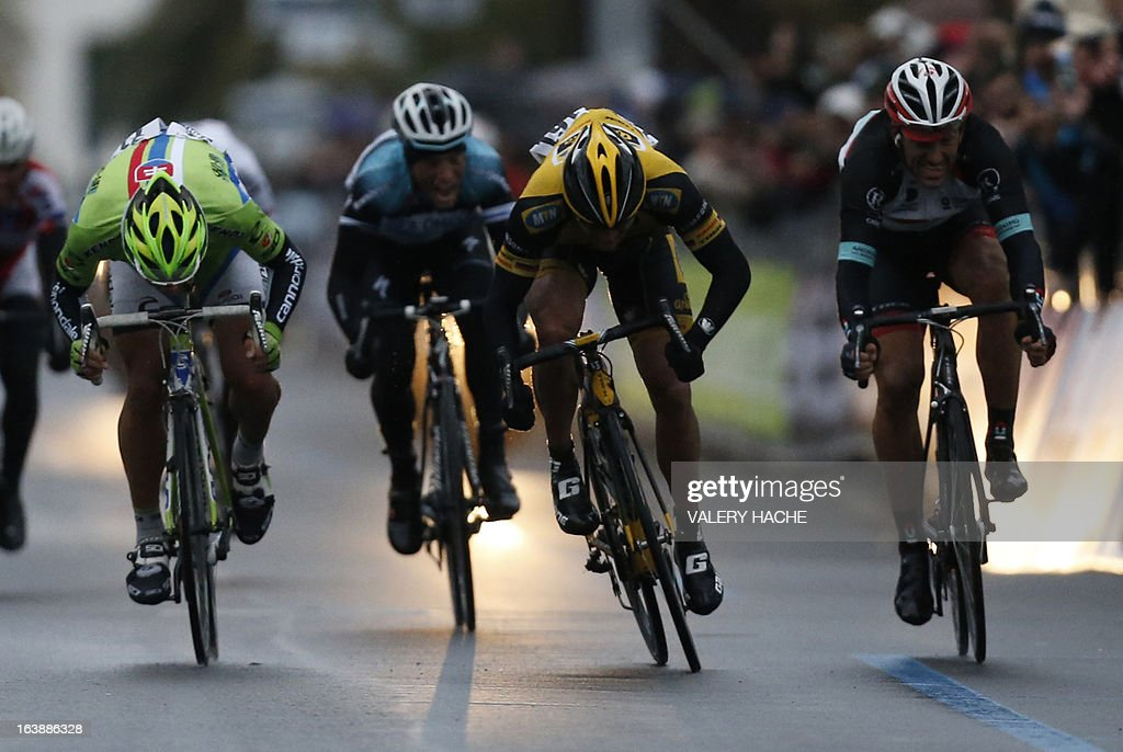 German Gerald Ciolek (yellow) crosses the finish line to win the 104th Milan San Remo spring classic cycling race on March 17, 2013 in San Remo. Gerald Ciolek of Germany, riding for South African team MTN-Qhueka, won the first cycling classic of the season, the Milan-Sanremo, triumphing in a race curtailed by heavy snow. The poor conditions forced the event to be temporarily halted after 117km. Organisers elected to restart the race for the final 126.5km from Cogoleto, meaning participants would still need to tackle the succession of hills along the Ligurian coast after proceedings were initially halted after 117km. AFP PHOTO / VALERY HACHE