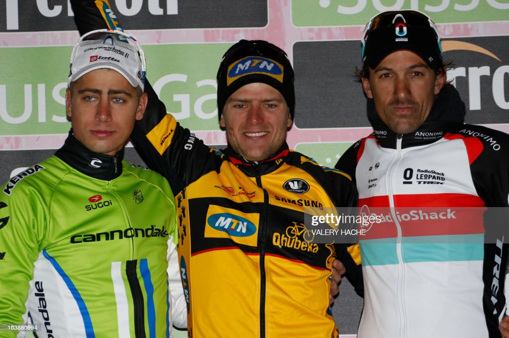 German Gerald Ciolek (C), first, Peter Sagan (L), second, and Switzerland's Fabian Cancellera (R) pose on the podium after the104th Milan San Remo spring classic cycling race on March 17, 2013 in San Remo. Gerald Ciolek of Germany, riding for South African team MTN-Qhueka, won the first cycling classic of the season, the Milan-Sanremo, triumphing in a race curtailed by heavy snow.