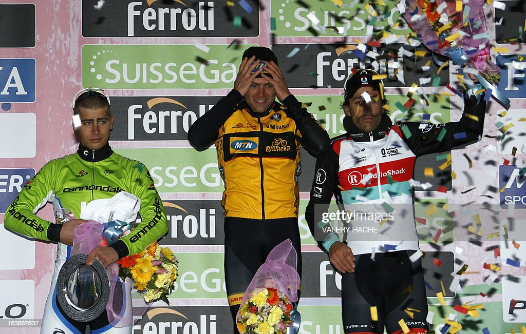 German Gerald Ciolek (C), first, Peter Sagan (L), second, and Switzerland's Fabian Cancellera (R) pose on the podium after the104th Milan San Remo spring classic cycling race on March 17, 2013 in San Remo. Gerald Ciolek of Germany, riding for South African team MTN-Qhueka, won the first cycling classic of the season, the Milan-Sanremo, triumphing in a race curtailed by heavy snow. AFP PHOTO / VALERY HACHE