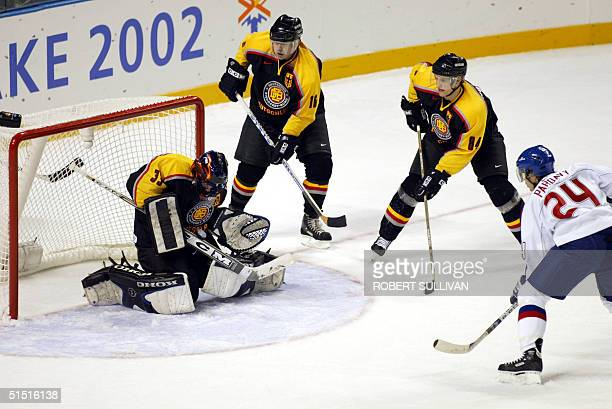 German goalie Marc Seliger stops a shot from Slovakia's Jan Pardavy during the XIX Winter Olympics 09 February 2002 in Salt Lake City Utah AFP...