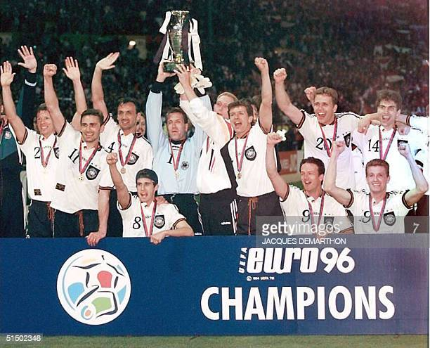 German goalkeeper Andreas Kopke holding the cup jubilates with his teammates after forward Oliver Bierhoff scored the firstever golden goal in extra...
