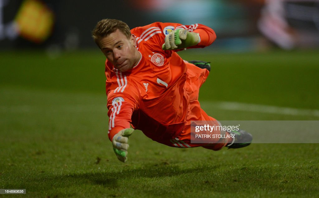 German goalkeeper Manuel Neuer dives for a ball during Germany vs Kazakhstan FIFA 2014 World Cup qualifying football match in Nuremberg, on March 26, 2013.