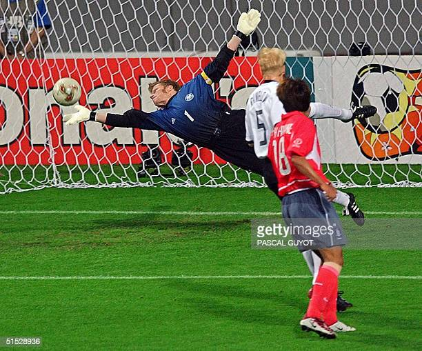 German goalkeeper Oliver Kahn dives to make a save following a shot by South Korea's Lee Chunsoo early in their semifinal match at Seoul World Cup...