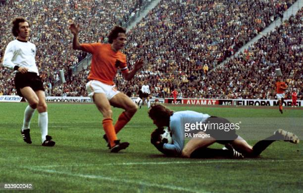 German goalkeeper Sepp Maier gathers the ball from Johann Cruyff of Holland as Franz Beckenbauer of Germany looks on