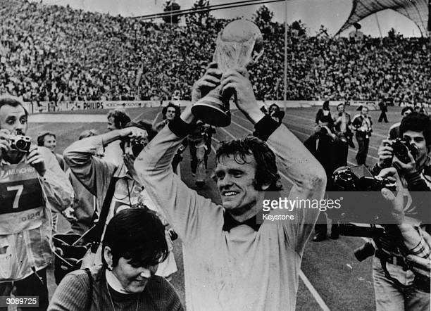German goalkeeper Sepp Maier holds the World Cup Trophy aloft after West Germany's 21 victory over Holland in the 1974 World Cup Final at the Olympic...