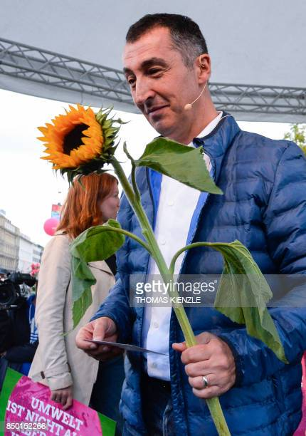 German Green Party coleader Cem Ozdemir holds a sunflower during an election campaign rally of the Alliance '90/Greens in Stuttgart southern Germany...