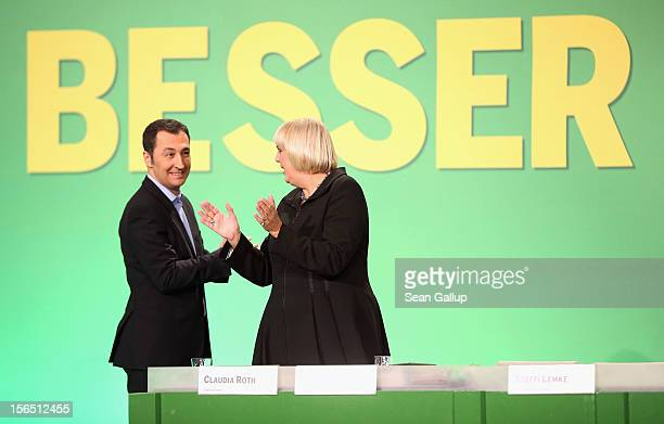 German Greens Party cochairleaders Claudia Roth and Cem Oezdemir attend the Greens party federal convention on November 16 2012 in Hanover Germany...