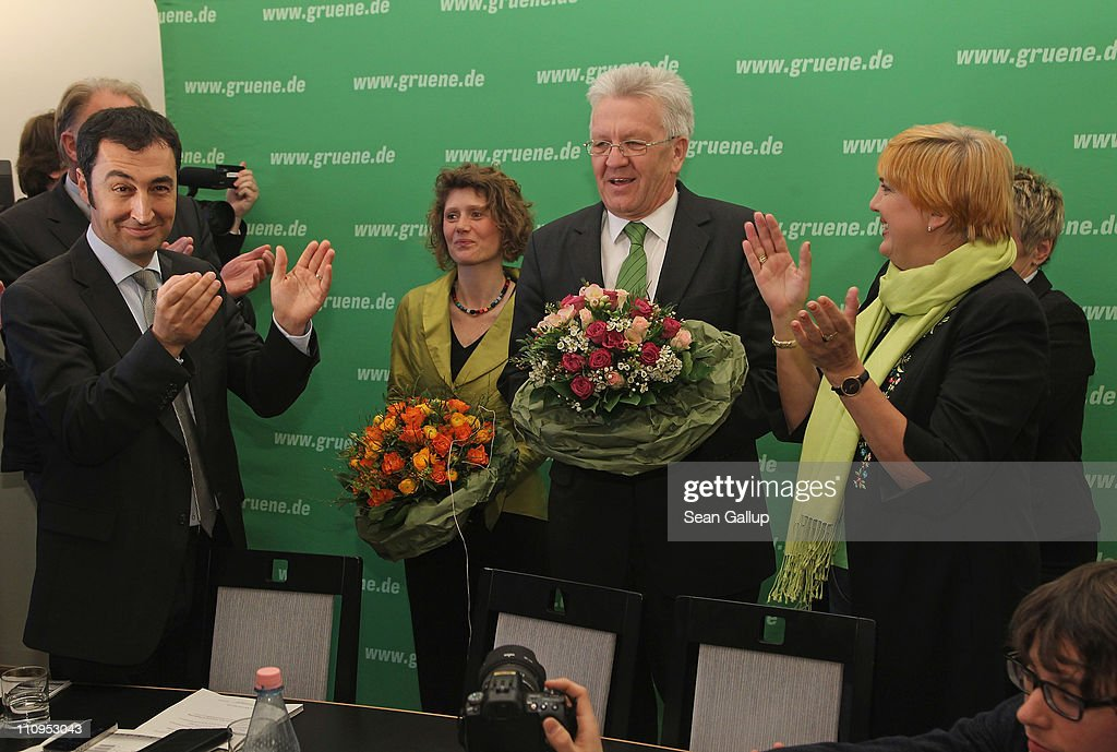 German Greens Party co-chairman <a gi-track='captionPersonalityLinkClicked' href=/galleries/search?phrase=Cem+Oezdemir&family=editorial&specificpeople=4535800 ng-click='$event.stopPropagation()'>Cem Oezdemir</a> (L) and co-chairwoman <a gi-track='captionPersonalityLinkClicked' href=/galleries/search?phrase=Claudia+Roth&family=editorial&specificpeople=235978 ng-click='$event.stopPropagation()'>Claudia Roth</a> (R) welcome Greens Party candidate in the state of Rhineland-Palatinate Eveline Lemke (C-L) and Greens Party candidate in the state of Baden-Wuerttemberg <a gi-track='captionPersonalityLinkClicked' href=/galleries/search?phrase=Winfried+Kretschmann&family=editorial&specificpeople=7227897 ng-click='$event.stopPropagation()'>Winfried Kretschmann</a> at the Greens Party headquarters the day after elections in Baden-Wuerttemberg and Rhineland-Palatinate on March 28, 2011 in Berlin, Germany. The Greens emerged as the second strongest party in Baden-Wuerttemberg and third strongest in Rhineland-Palatinate, and analysts credit the party's spectacular results with, among others, popular reaction in Germany against nuclear power following the ongoing disaster at the Fukushima facility in Japan. In Baden-Wuerttemberg the Greens will likely be able to install a Greens Party governor, breaking a 57-year hold on power by the German Christian Democrats (CDU).