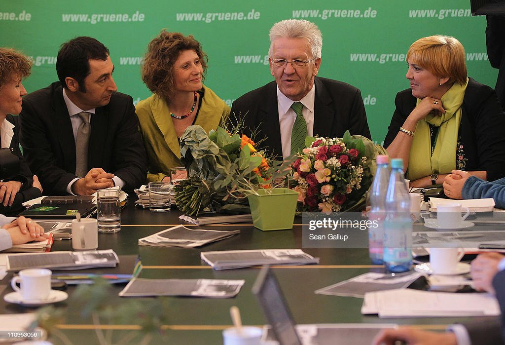 German Greens Party co-chairman <a gi-track='captionPersonalityLinkClicked' href=/galleries/search?phrase=Cem+Oezdemir&family=editorial&specificpeople=4535800 ng-click='$event.stopPropagation()'>Cem Oezdemir</a> (L) and co-chairwoman <a gi-track='captionPersonalityLinkClicked' href=/galleries/search?phrase=Claudia+Roth&family=editorial&specificpeople=235978 ng-click='$event.stopPropagation()'>Claudia Roth</a> (R) sit down for a party meeting with Greens Party candidate in the state of Rhineland-Palatinate Eveline Lemke (C-L) and Greens Party candidate in the state of Baden-Wuerttemberg <a gi-track='captionPersonalityLinkClicked' href=/galleries/search?phrase=Winfried+Kretschmann&family=editorial&specificpeople=7227897 ng-click='$event.stopPropagation()'>Winfried Kretschmann</a> at the Greens Party headquarters the day after elections in Baden-Wuerttemberg and Rhineland-Palatinate on March 28, 2011 in Berlin, Germany. The Greens emerged as the second strongest party in Baden-Wuerttemberg and third strongest in Rhineland-Palatinate, and analysts credit the party's spectacular results with, among others, popular reaction in Germany against nuclear power following the ongoing disaster at the Fukushima facility in Japan. In Baden-Wuerttemberg the Greens will likely be able to install a Greens Party governor, breaking a 57-year hold on power by the German Christian Democrats (CDU).