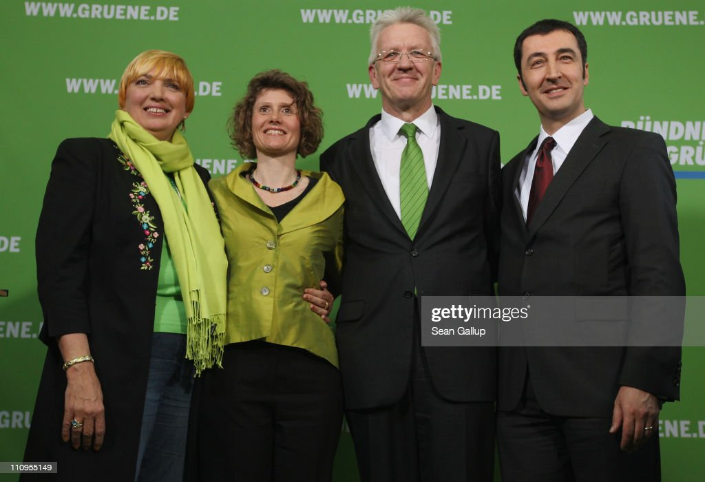 German Greens Party co-chairman <a gi-track='captionPersonalityLinkClicked' href=/galleries/search?phrase=Cem+Oezdemir&family=editorial&specificpeople=4535800 ng-click='$event.stopPropagation()'>Cem Oezdemir</a> (R) and co-chairwoman <a gi-track='captionPersonalityLinkClicked' href=/galleries/search?phrase=Claudia+Roth&family=editorial&specificpeople=235978 ng-click='$event.stopPropagation()'>Claudia Roth</a> (R) pose with Greens Party candidate in the state of Rhineland-Palatinate Eveline Lemke (C-L) and Greens Party candidate in the state of Baden-Wuerttemberg <a gi-track='captionPersonalityLinkClicked' href=/galleries/search?phrase=Winfried+Kretschmann&family=editorial&specificpeople=7227897 ng-click='$event.stopPropagation()'>Winfried Kretschmann</a> after a press conference at the Greens Party headquarters the day after elections in Baden-Wuerttemberg and Rhineland-Palatinate on March 28, 2011 in Berlin, Germany. The Greens emerged as the second strongest party in Baden-Wuerttemberg and third strongest in Rhineland-Palatinate, and analysts credit the party's spectacular results with, among others, popular reaction in Germany against nuclear power following the ongoing disaster at the Fukushima facility in Japan. In Baden-Wuerttemberg the Greens will likely be able to install a Greens Party governor, breaking a 57-year hold on power by the German Christian Democrats (CDU).