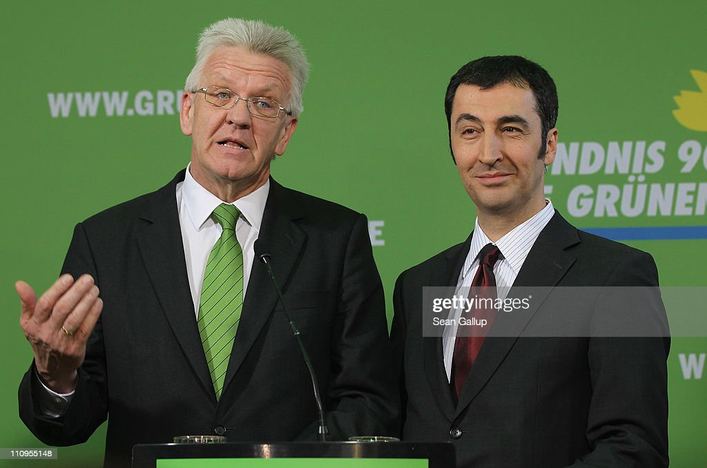German Greens Party co-chairman <a gi-track='captionPersonalityLinkClicked' href=/galleries/search?phrase=Cem+Oezdemir&family=editorial&specificpeople=4535800 ng-click='$event.stopPropagation()'>Cem Oezdemir</a> (R) and Greens Party candidate in the state of Baden-Wuerttemberg <a gi-track='captionPersonalityLinkClicked' href=/galleries/search?phrase=Winfried+Kretschmann&family=editorial&specificpeople=7227897 ng-click='$event.stopPropagation()'>Winfried Kretschmann</a> speak to the media at Greens Party headquarters the day after elections in Baden-Wuerttemberg and Rhineland-Palatinate on March 28, 2011 in Berlin, Germany. The Greens emerged as the second strongest party in Baden-Wuerttemberg and third strongest in Rhineland-Palatinate, and analysts credit the party's spectacular results with, among others, popular reaction in Germany against nuclear power following the ongoing disaster at the Fukushima facility in Japan. In Baden-Wuerttemberg the Greens will likely be able to install a Greens Party governor, breaking a 57-year hold on power by the German Christian Democrats (CDU).
