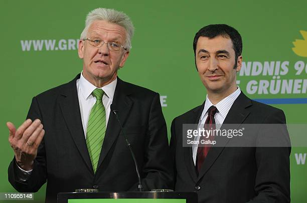 German Greens Party cochairman Cem Oezdemir and Greens Party candidate in the state of BadenWuerttemberg Winfried Kretschmann speak to the media at...