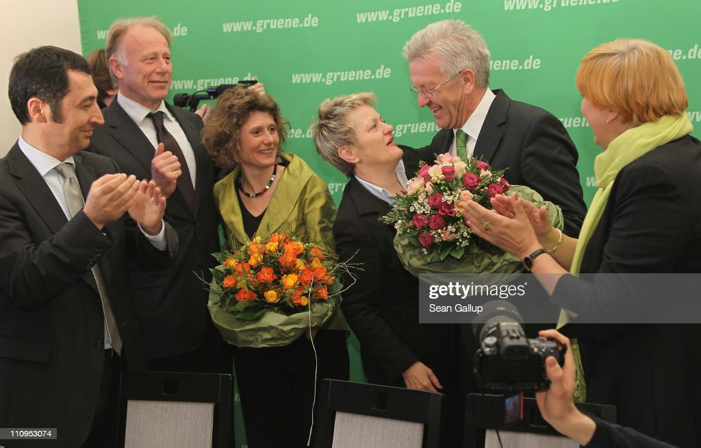 German Greens Party co-chairman <a gi-track='captionPersonalityLinkClicked' href=/galleries/search?phrase=Cem+Oezdemir&family=editorial&specificpeople=4535800 ng-click='$event.stopPropagation()'>Cem Oezdemir</a> (L), co-chairwoman <a gi-track='captionPersonalityLinkClicked' href=/galleries/search?phrase=Claudia+Roth&family=editorial&specificpeople=235978 ng-click='$event.stopPropagation()'>Claudia Roth</a> (R), co-Bundestag Greens Party faction leaders <a gi-track='captionPersonalityLinkClicked' href=/galleries/search?phrase=Juergen+Trittin&family=editorial&specificpeople=571129 ng-click='$event.stopPropagation()'>Juergen Trittin</a> (2nd from L) and Renate Kuenast (3rd from R) welcome Greens Party candidate in the state of Rhineland-Palatinate Eveline Lemke (C-L) and Greens Party candidate in the state of Baden-Wuerttemberg <a gi-track='captionPersonalityLinkClicked' href=/galleries/search?phrase=Winfried+Kretschmann&family=editorial&specificpeople=7227897 ng-click='$event.stopPropagation()'>Winfried Kretschmann</a> at the Greens Party headquarters the day after elections in Baden-Wuerttemberg and Rhineland-Palatinate on March 28, 2011 in Berlin, Germany. The Greens emerged as the second strongest party in Baden-Wuerttemberg and third strongest in Rhineland-Palatinate, and analysts credit the party's spectacular results with, among others, popular reaction in Germany against nuclear power following the ongoing disaster at the Fukushima facility in Japan. In Baden-Wuerttemberg the Greens will likely be able to install a Greens Party governor, breaking a 57-year hold on power by the German Christian Democrats (CDU).
