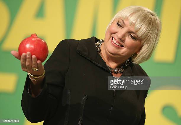 German Greens Party cochairwoman Claudia Roth holds a pomegranate from Afghanistan she received as a gift while attending the Greens party federal...